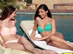 Cute lesbians Nina North and Ellena Woods get frisky in pool