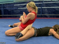 Debbie White and Blue Angel are fighting furiously on a ring